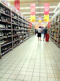 People buying drinks. In a supermarket Stock Images