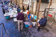 People buying fish from Catania fish market Stock Photography