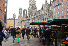 People buying  flowers in Munich,Germany. People buy flowers at a flower market in Munich,Germany Stock Photography
