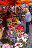 People buying flowers at the street flower shop Royalty Free Stock Images