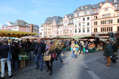 People buying food and plants at the Farmers Market Royalty Free Stock Images