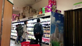 People buying food in T&T supermarket stock video footage