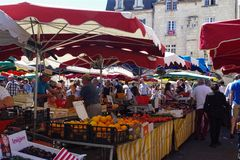 People buying vegetable on stall at the fresh market in a old european city. stock photography