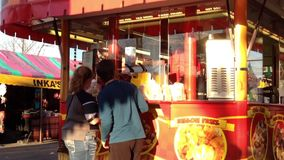People buying fries at food booths Royalty Free Stock Photo