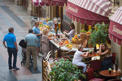 People buying fruit and soft drinks Royalty Free Stock Photography
