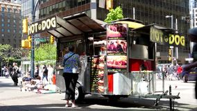 People buying hot dog at street. Of downtown Vancouver stock video