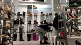 People buying new shoes. One side of people buying new shoes inside Steve madden shoes store stock video