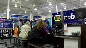 People buying new smart phone inside Best buy store stock video