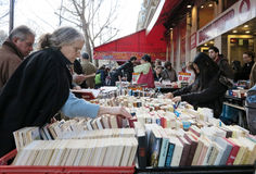 People buying old books. In the Latin Quarter of Paris Stock Photo