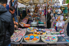 People buying oriental souvenirs at the street shop Royalty Free Stock Photo