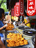 People Buying Persimmon Cakes at China Xi`an Muslim Food Street royalty free stock photography