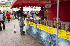 People buying preserved fish in plastic cans Royalty Free Stock Image