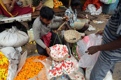 People buying and selling flowers and garlands at the flower market in Kolkata Stock Photography
