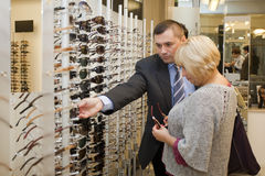 People buying sunglasses Royalty Free Stock Photos