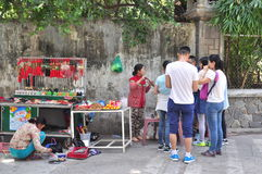 People are buying things for worship in a pagoda on the first day of the lunar new year in Vietnam Royalty Free Stock Photo