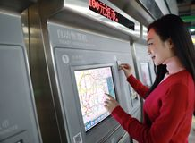 People buying ticket automatic machine Royalty Free Stock Images