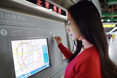 People buying ticket automatic machine Stock Images