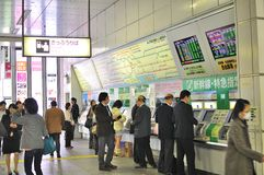 People buying tickets at Akihabara JR station. People buying tickets on the automatic ticket machines at Akihabara Station, in Tokyo Japan Royalty Free Stock Image