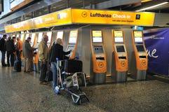 Buying flight tickets in Frankfurt Airport. Passengers buying flight tickets from tickets machine place inside International Frankfurt Airport Stock Image