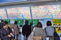 People buying tickets at Shinjuku JR station. People buying tickets on the automatic ticket machines at Shinjuku Station, in Tokyo Japan Royalty Free Stock Photos
