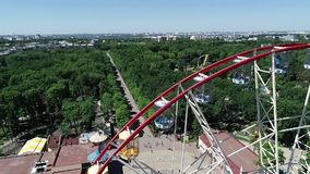 People in the cabin Ferris wheel, shooting with the drone. Beautiful frame of a ferris wheel in a picturesque place.  stock footage