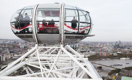 People are in the cabin of London Eye. London, United Kingdom - October 31, 2017: People are in the cabin of London Eye giant Ferris wheel mounted on the South stock images
