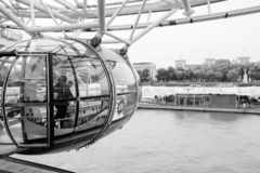People are in cabin of London Eye. London, United Kingdom - October 31, 2017: People are in cabin of London Eye giant Ferris wheel mounted on the South Bank of royalty free stock image