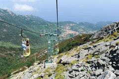 People on the cable car going up mount Capanne Stock Photos