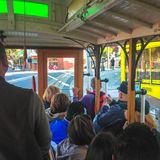 People in cable car in San Francisco, California, USA. Spring 2015. People in cable car in San Francisco, California, USA stock image