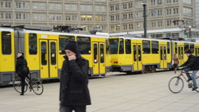 People, Cable car and train traffic at Berlin district Mitte at Alexanderplatz. MITTE, BERLIN/ GERMANY FEBRUARY 10 2015: People, Cable car and train traffic at stock footage