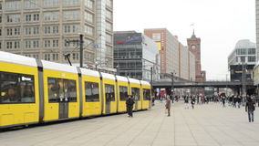 People, Cable car and train traffic at Berlin district Mitte at Alexanderplatz. MITTE, BERLIN/ GERMANY FEBRUARY 10 2015: People, Cable car and train traffic at stock video footage