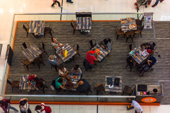 People in a cafe in Dubai Mall shopping center. UAE, DUBAI - DECEMBER 25: people in a cafe in Dubai Mall shopping center on December 25, 2014. Top view Royalty Free Stock Image