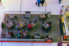 People in a cafe in Dubai Mall shopping center. UAE, DUBAI - DECEMBER 25: people in a cafe in Dubai Mall shopping center on December 25, 2014. Top view Royalty Free Stock Photography