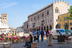 People and cafe on Piazza Sordello in Mantua. MANTUA, ITALY - MARCH 31, 2017: people and cafe on Piazza Sordello Piazza San Pietro near Palazzo Ducale di Mantova Stock Photo