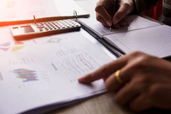 People calculate about and note data cost at home. Finance managers task,Concept business and finance Stock Photography