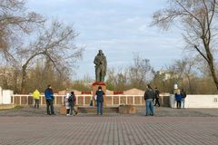 People came to the Alesha - a monument to soldiers of the WWII near the Victory Memorial of the Krasnoyarsk. KRASNOYARSK, RF - May 9, 2018: People came to the stock image