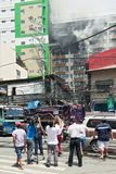 People and camera man watching a fire in Binondo, Manila stock image