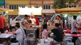 People can seen having dinner and exploring around Seri Kembangan night market on Monday. Kuala Lumpur,Malaysia - Oct 13,2019 : People can seen having dinner and stock video
