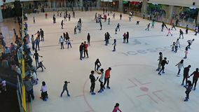 People can seen playing ice skating in IOI City Mall which is located at Putrajaya Malaysia. stock video footage