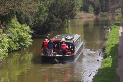People on canal boat. Sailing down river Stock Images