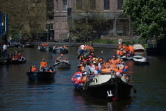People on the canal boats in Amsterdam Stock Photo