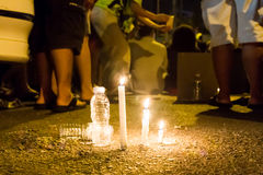 People with candle vigil in darkness seeking hope, worship, pray Royalty Free Stock Images