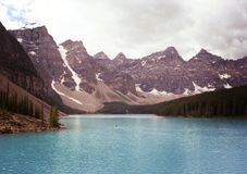 People Canoeing at Lake Moraine Banff Alberta royalty free stock photography