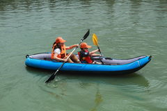 People canoeing on scenic lake in summer, shanghai Stock Images
