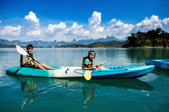 People canoeing on scenic lake in summer, THAILAND Stock Photos