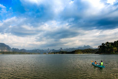People canoeing on scenic lake in summer, THAILAND Stock Photography