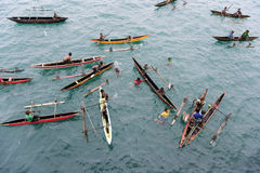 People in canoes on Pacific Ocean Royalty Free Stock Photography