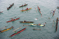 People in canoes on Pacific Ocean Stock Images
