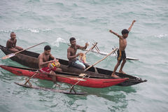 Traders in canoes on Pacific Ocean Stock Photography