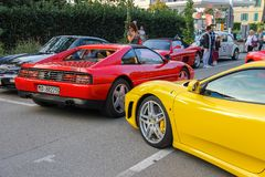 People on car exhibition from Ferrari Museum on streets of Spila. Spilamberto, Italy- October 02, 2016: People on car exhibition from Ferrari Museum on streets Royalty Free Stock Photography